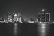 Detroit at Night Black and White. Downtown Detroit, Michigan as seen from across the Detroit river in Windsor, Canada. Shot late at night and carefully edited in black and white.