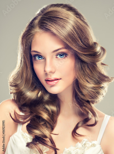 Beautiful young girl with long hairstyle curly hair Poster