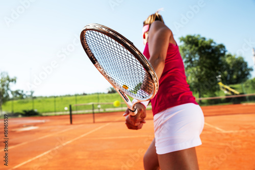 Plakát Young woman playing tennis