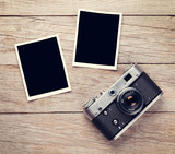 Fototapeta Vintage film camera and two blank photo frames