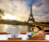 Coffee with croissants against Eiffel Tower in Paris, France - 87041568