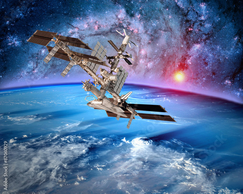 Fototapeta Earth satellite space station spaceship orbit sci fi landscape. Elements of this image furnished by NASA.