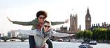 happy teenage couple having fun over london city