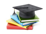Mortarboard standing on book stack