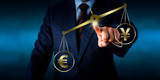 Euro Sign Outweighing The Yuan On A Golden Scale poster