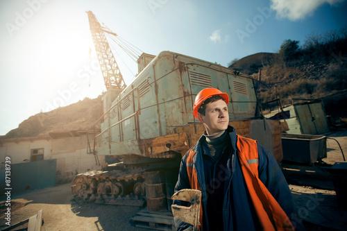 Poster Portrait worker man in helmet on mine career.