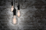 Fototapety Idea concept - Vintage incandescent bulbs on wall background