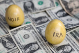 Retirement golden eggs on dollars, IRA in focus, 401k blurry poster