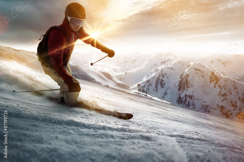 Skier in a sunset setting Poster
