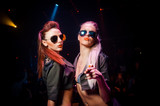 Fototapety Two sexy girls in sunglasses. The club