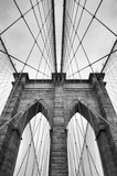Fototapety Brooklyn Bridge New York City close up architectural detail in timeless black and white