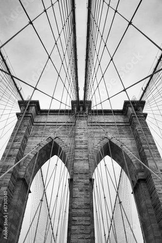Fototapety, obrazy : Brooklyn Bridge New York City close up architectural detail in timeless black and white