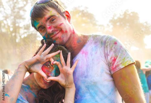Foto op Canvas Bedehuis Happy couple in love on holi color festival