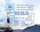 Businessman standing on a rock and looking at the future perspectives of MBA degree. Mountain landscape. poster