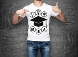Close-up of a man pointing his finger to the chest with the sketch of the graduation hat. A concept of the MBA degree. shooting mark. Black chalk board on background. poster