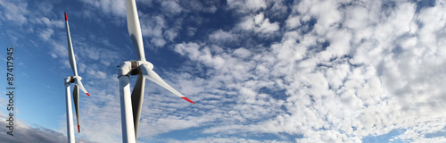 energy wind turbines on blue sky with clouds