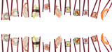 Many different sushi and rolls in chopsticks isolated on white background