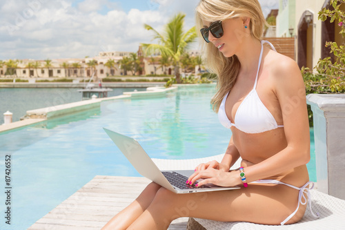 Business woman working with laptop computer outdoors