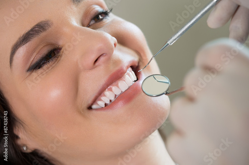 Young woman at the dentist - 87438743