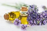 Fototapety Wellness treatments with lavender flowers on wooden table. Spa still-life.