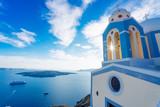 Santorini beautiful church, sun and volcanic caldera with cruise ships, Greece