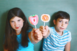 siblings  with fruit  marsh mellow candies on stick poster