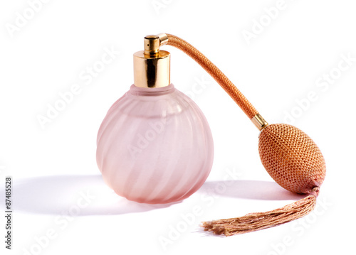 Plakat Swirling pink perfume bottle and atomizer