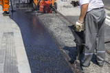 Workers laying stone mastic asphalt poster