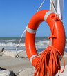 Постер, плакат: Orange jackets with rope to rescue swimmers in the sea in summer