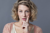 threatening 20s blonde girl showing her index finger for signal of danger, risk or behaving with focus poster