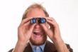 Excited voyeur watching through binoculars