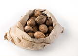 walnuts in paper bag isolated on white