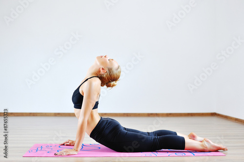 Woman in the cobra yoga pose плакат
