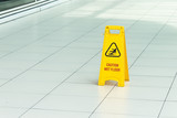 Yellow sign that alerts for wet floor.