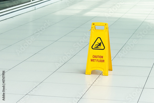 Poster Yellow sign that alerts for wet floor.