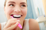Woman brushing cleaning teeth. Oral hygiene.