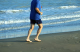 mature athlete runs on the Sea Beach to keep fit