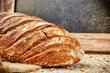 Freshly baked bread loaf in rustic setting