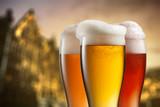 Glasses of beer against blurred european city