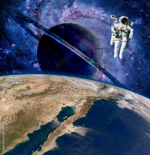 Earth astronaut planet outer space saturn spaceman cosmonaut. Elements of this image furnished by NASA. - 87769563