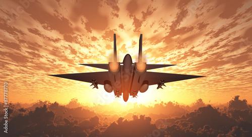 wojskowy-odrzutowiec-w-locie-wschod-lub-zachod-slonca