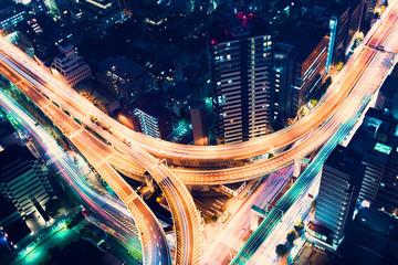 Aerial-view highway junction at night in Tokyo, Japan