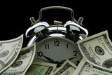 close up of the oldfashioned alarm clock with money poster