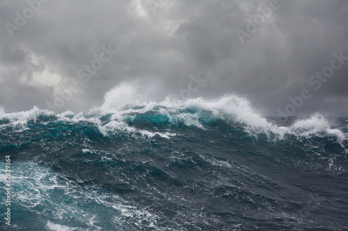 Poster sea wave during storm in atlantic ocean