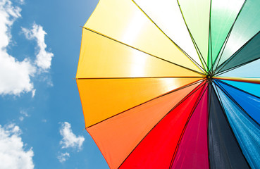 Colorful umbrella under blue sky