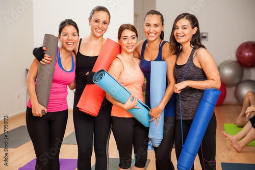 Poster Group of girls in a yoga studio