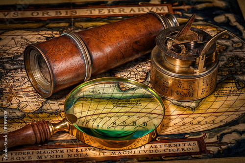 Poster Old vintage compass on ancient map