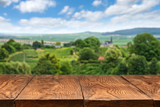 Fototapety wooden table with vineyard landscape
