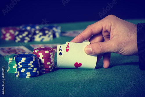 Poster Closeup of poker player with two aces