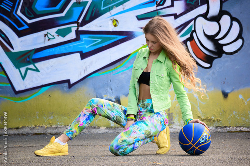 Girl on graffiti background © acherst